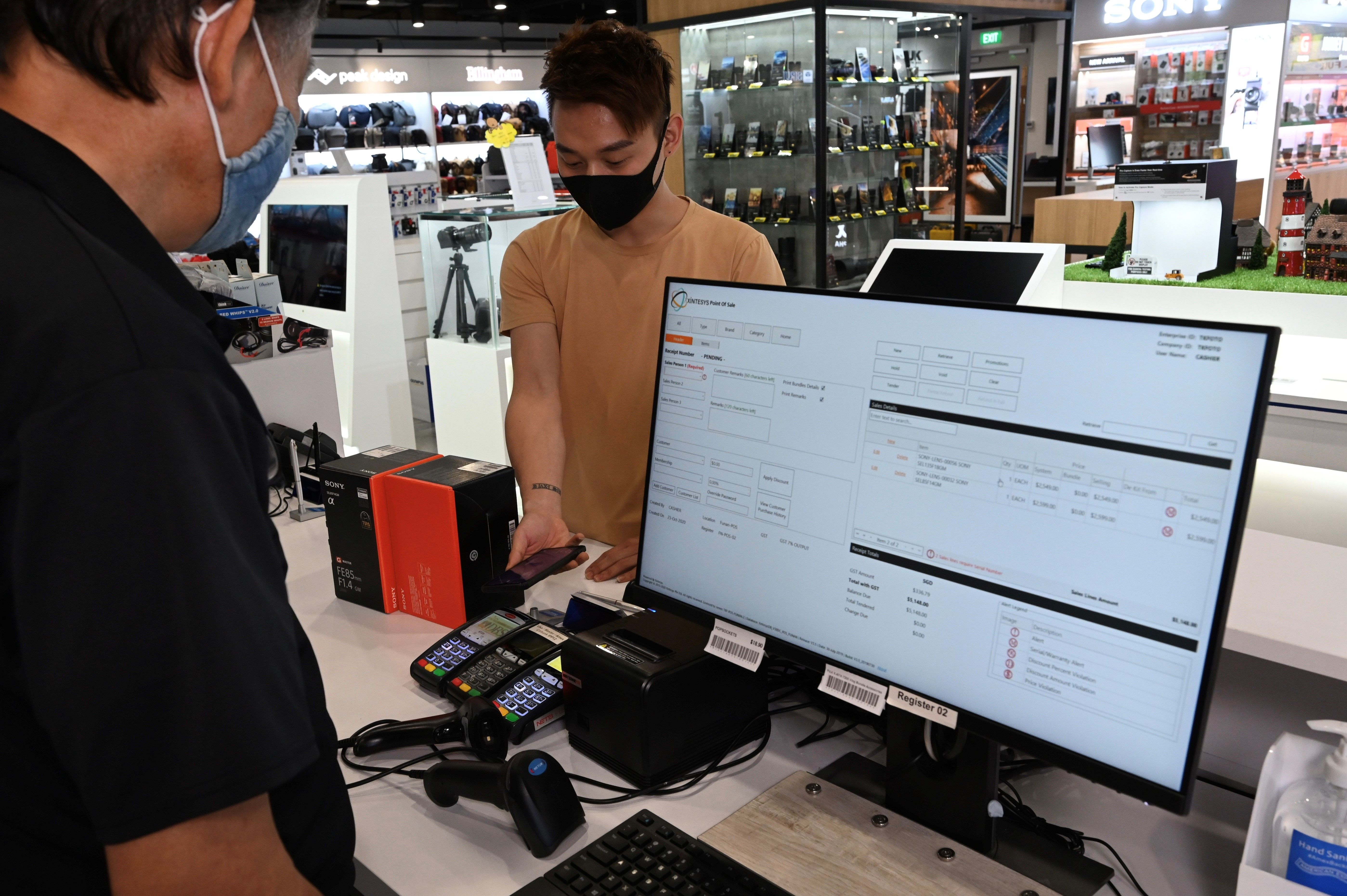 T K Foto staff using a Sales and Inventory Management solution which seamlessly integrates its POS data and inventory tracking.